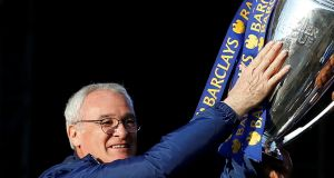 New Fulham manager Claudio Ranieri holds aloft the Premier League trophy after winning it with Leicester City. Photo: Carl Recine/File Photo/Reuters