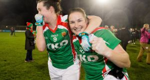 Carnacon's Erina Flannery and Michelle McGing celebrate after beating Mourneabbey in the All-Ireland Ladies Senior Club Football Championship Final in Parnell Park. Photograph: Oisin Keniry/Inpho