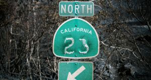 A fire-damaged road sign on Decker Road in Malibu. At least 48 people have died in the Camp Fire, the deadliest wildfire in the state's history. Photograph: Stuart Palley/The New York Times