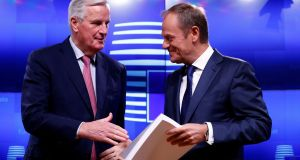 European Union's chief Brexit negotiator Michel Barnier meets European Council President Donald Tusk to hand over the Brexit draft text in Brussels. Photograph: Francois Lenoir/Reuters