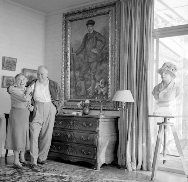 Father and son: Jean Renoir with Pierre-Auguste's painting of him as a boy, in a photograph by Sanford Roth. Courtesy UCLA Library Special Collections