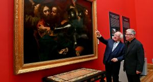 President Michael D Higgins with Fr Noel Barber SJ, at the  National Gallery of Ireland, to mark the 25th anniversary of unveiling of Caravaggio's 'The Taking of Christ'. Photograph:  Maxwell