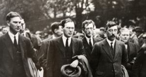 Ernest Blythe (holding hat) in the funeral procession for Michael Collins, 1922. Photograph: Courtesy of National Library of Ireland.