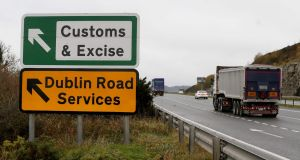 A lorry passes a sign on a main road outside Newry pointing towards an old customs and excise station near the Border. Photograph: Paul Faith/AFP/Getty Images