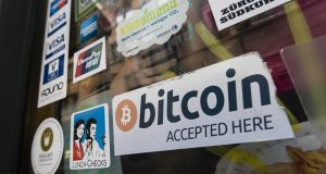 """Bitcoin accepted"" sign in the window of a cafe in Zurich. Photograph: iStock"