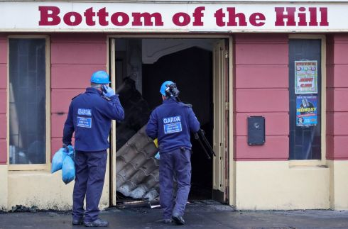 Garda crime scene investigators collect possible evidence from the Botton of the Hill Pub, Finglas Village, which went of fire last night, destroying the pub. Photograph: Colin Keegan/Collins