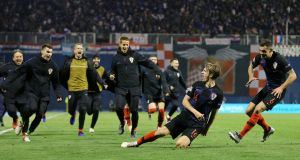 Croatia's Tin Jedvaj celebrates scoring their third goal with team-mates during the Nations League match against  Spain at Stadion Maksimir in Zagreb. Photograph: Antonio Bronic/Reuters