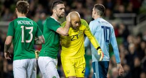 Shane Duffy congratulates Darren Randolph after the Republic of Ireland goalkeeper made a crucial save during the friendly international against Northern Ireland at the Aviva stadium. Photograph:  Morgan Treacy/Inpho