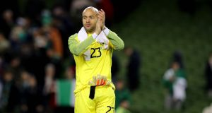 Republic of Ireland's Darren Randolph applauds the fans after the game. Photograph: Ryan Byrne/Inpho