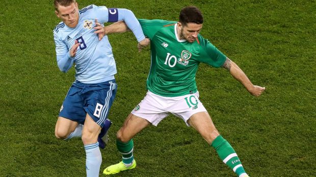 Northern Ireland captain Steven Davis challenges Robbie Brady during the friendly international at the Aviva stadium. Photograph: Tommy Dickson/Inpho