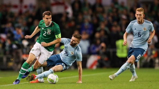 Séamus Coleman skips away from Stuart Dallas during the friendly international at the Aviva stadium. Photograph: Ryan Byrne/Inpho