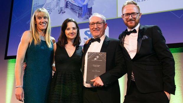 Cathal McGuinness, Director, SAS International presents the Fit Out Project of the Year award to Carole Smillie, Bennett Construction, Maria Mulcahy & Robert Salmon, Henry J Lyons.