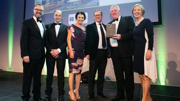 Justin Treacy, Director, RKD presents the Fit Out Contractor of the Year award to Ardmac team.