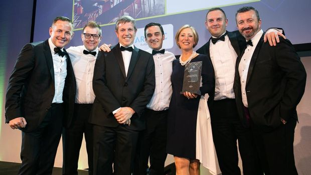 Sarah McDonnell, Head of Interiors, Ardmac presents the Fit Out Professional Consultancy of the Year award to Ethos Engineering team.