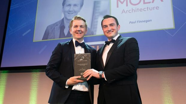 Dave Merriman, Director, T&I Fitouts presents the Young Fit Out Designer of the Year award to Paul Finnegan, MOLA Architecture