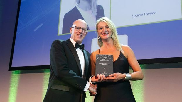 Matt Mohan, CEO, The FKM Group presents the Fit Out Project Manager of the Year award to Louise Dwyer, JLL.