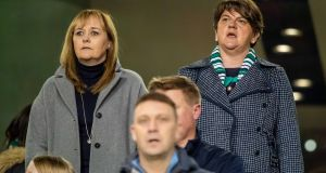 DUP leader Arlene Foster (right) stands for 'God Save the Queen' as Northern Ireland took on the Republic of Ireland at the  Aviva Stadium, Dublin. Photograph: INPHO/Morgan Treacy