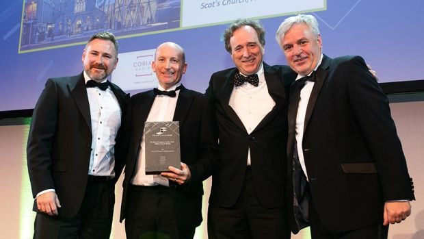 Adrian Ewart, Ireland Sales Manager, Corian® Design presents the Fit Out Project of the Year - Office New Build award to Robert McCauley, Michael Owen & Rob Murray, McCauley Daye O'Connell Architects