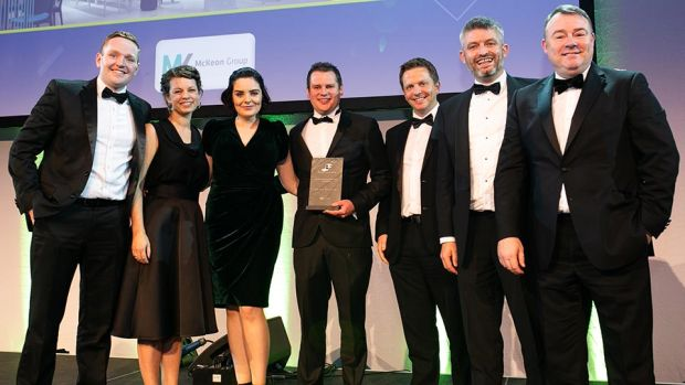 Tomás G. Mac Eoin, Managing Director, McKeon Group presents the Fit Out Project of the Year - Hospitality award to the Henry J Lyons team