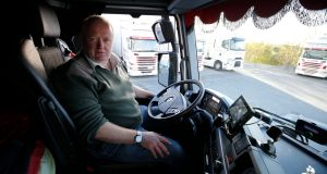 Driver John Carroll gets ready to  leave  Dublin for  Germany.  Photograph:  Nick Bradshaw for The Irish Times