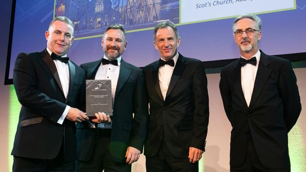 Tom Murnane, Commercial Director, StructureTone presents the Fit Out Project of the Year - Conservation award to Rob Murray, VHI Healthcare, Dan Daye & Kevin Treacy, McCauley Daye O'Connell Architects