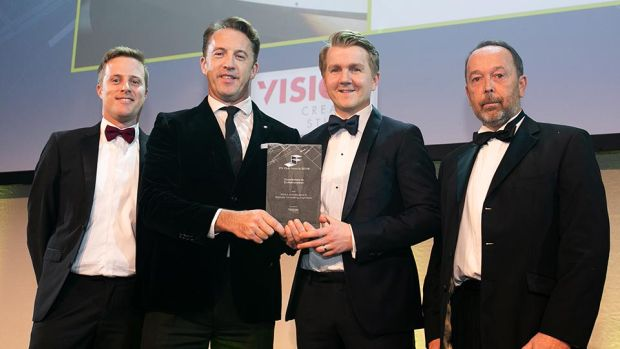 Aaron O'Grady, Managing Director, Vision Creative Studios presents the Excellence in Collaboration award to Dara Murphy, Paul Finnegan, MOLA Architecture & Chris Bakkala, Bakkala Consulting Engineering.