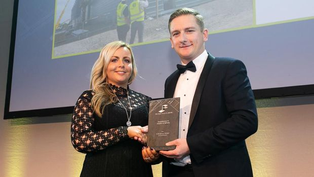 Stuart McFadden, Operations Manager, Fiontar Safety Management presents the Excellence in Health & Safety award to Gillian O'Donoghue, ACB Group Design & Construct.