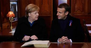 Angela Merkel and Emmanuel Macron  in a replica of the wagon where the Armistice was signed in 1918, in the Clairiere of Rethondes forest, during a commemoration ceremony for Armistice Day. Photograph: Philippe Wojazer/EPA