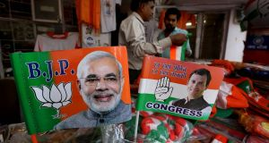 Election material with pictures of Indian prime minister Narendra Modi and Congress party president Rahul Gandhi in a shop in Bhopal. Photograph: Sanjeev Gupta/EPA
