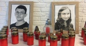 Photographs of Slovak investigative journalist Jan Kuciak and his fiancee, Martina Kusnirova, in the office of the Aktuality.sk news outlet in Bratislava where he worked. They were shot dead in February.