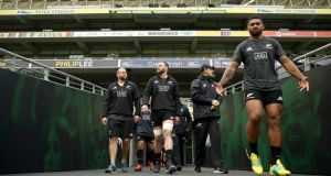 Kieran Read (centre) walks out for the New Zealand captain's run with Joe Moody  and Waisake Naholo at the Aviva stadium on Friday. Photograph: Phil Walter/Getty Images