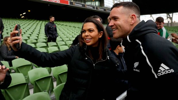 Ryan Crotty takes pictures with fans during the captain's run. Photograph: Ryan Byrne/Inpho