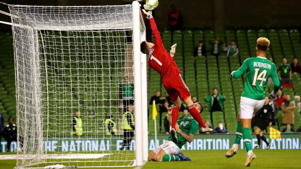 Northern Ireland's Bailey Peacock-Farrell saves a header from Shane Duffy. Photograph: Ryan Byrne/Inpho