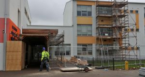 Builders engaged in remedial work at Tyrrelstown Educate Together School. Photograph: Colin Keegan/Collins