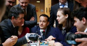 Taoiseach, Leo Varadkar and Minister for Finance and Public Expenditure Paschal Donohoe with students at Larkin Community College at the at the launch of a project to boost pupils' opportunities in the digital economy. Photograph:  Nick Bradshaw