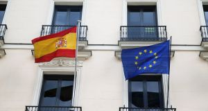 The European Union flag and the Spanish flag are seen on a building in Madrid. The draft Brexit agreement includes a Gibraltar-specific protocol creating several working groups between Madrid and London. File photograph: Reuters