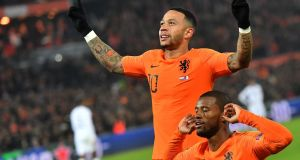 Netherlands' Georginio Wijnaldum (right) celebrates with team-mate  Memphis Depay after scoring in the  Uefa Nations League  match against  France at the Feijenoord stadium in Rotterdam. Photograph:  Emmanuel Dunand/AFP/Getty Images