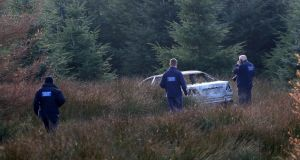 One of the suspected getaway vehicles used by the gunmen who killed  Clive Staunton in Co Kildare last night is seen at Ballyfolan in the Wicklow Mountains. Photograph: Collins