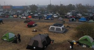 Tents pitched in a field next to a Walmart parking lot in Chico, California, where Camp Fire evacuees have been staying. Photograph: Justin Sullivan/Getty Images