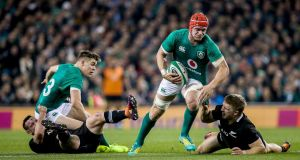 Ireland's Josh van der Flier with with Jack Goodhue of New Zealand. Photograph: Gary Carr/Inpho