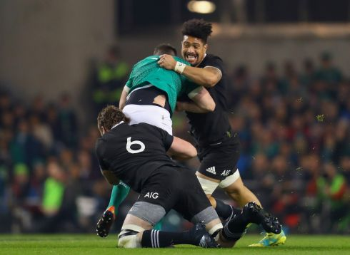 Ireland's Johnny Sexton tackled by Liam Squire and Ardie Savea of New Zealand. Photograph: Oisín Keniry/Inpho