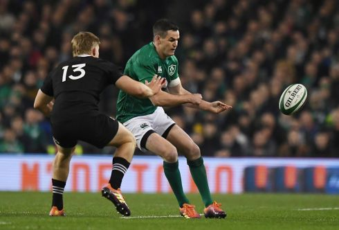 Ireland's Johnny Sexton in action with New Zealand's Jack Goodhue. Photograph: Clodagh Kilcoyne/Reuters