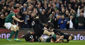 Jacob Stockdale scores a try during the autumn international against New Zealand at the Aviva stadium.  Photograph: Charles McQuillan/Getty Images