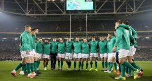 The Ireland team huddle after the All Blacks performed the Haka prior to the Guinness Series Test match at the Aviva stadium. Photo: Dan Sheridan/Inpho