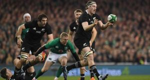 New Zealand's Brodie Retallick passes as Keith Earls moves in to make a tackle during the autumn international at the Aviva stadium. Photograph: Clodagh Kilcoyne/Reuters