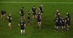 New Zealand players stand dejected at the end of the game. Photo: Tommy Dickson/Inpho