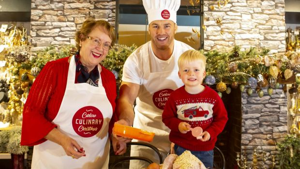 Sean O'Brien prepares for Carlow Culinary Christmas with Rachel Doyle of The Arboretum and three-year-old Iarlaith Flannery. Photograph: Mary Browne