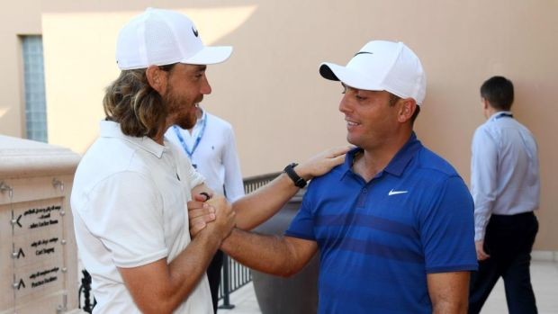Tommy Fleetwood shakes hands with Francesco Molinari after the Italian had secured the Race to Dubai title. Photograph: Ross Kinnaird/Getty