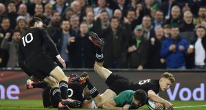 Jacob Stockdale scores Ireland's crucial try against New Zealand at the Aviva Stadium.   Photograph: Charles McQuillan/Getty Images