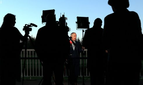 LIGHTS, CAMERA, ACTION: Richard Bruton TD speaks to the media at the recent Fien Gael Árd Fheis. Photograph: Nick Bradshaw/The Irish Times